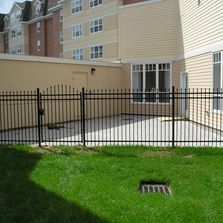 Black ornemental fence with gate